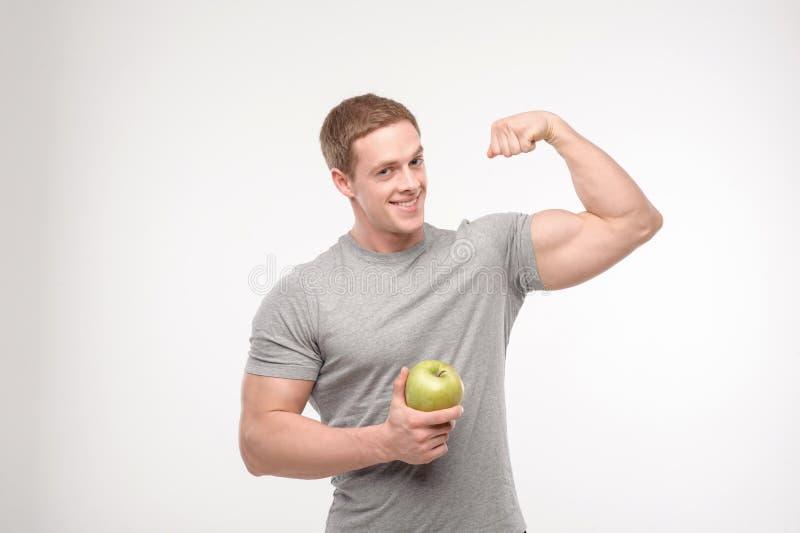 Atleet met een appel stock fotografie