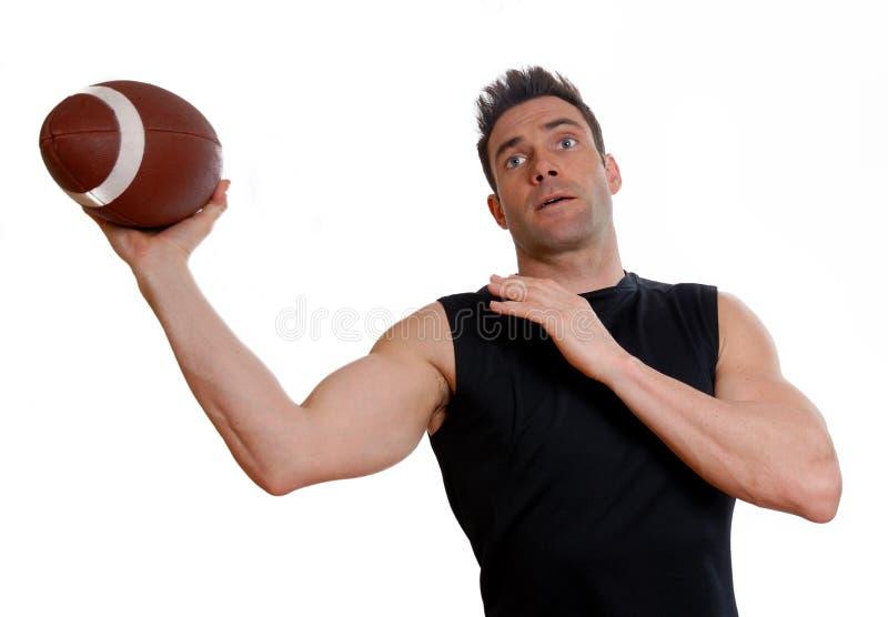 Atleet met voetbal stock foto's