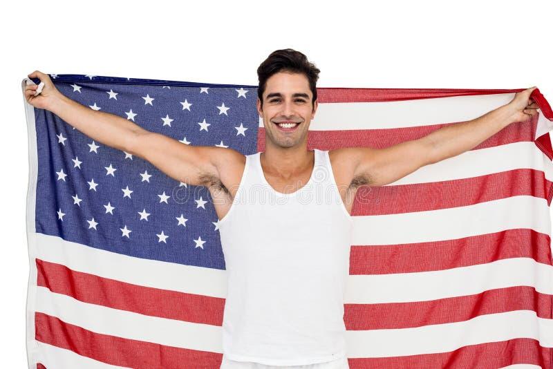 Atleta che posa con la bandiera americana dopo la vittoria immagine stock libera da diritti