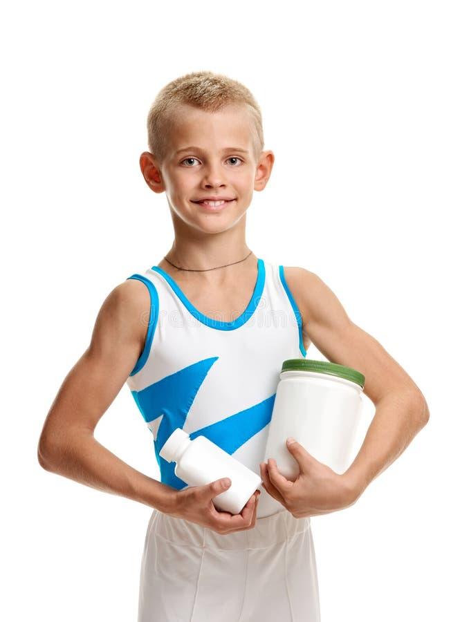 Atleta con il barattolo delle vitamine immagine stock libera da diritti
