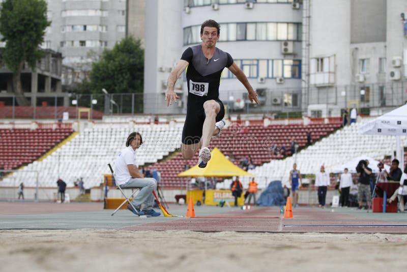 Atleta di salto triplo - Marian Oprea immagini stock libere da diritti