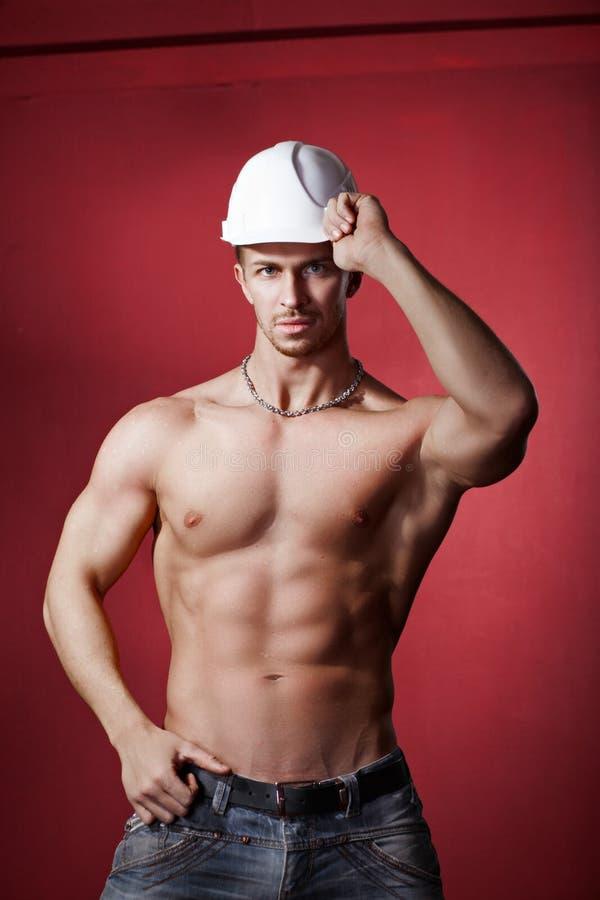 Atleta en el casco de la construcción Trabajo imagen de archivo