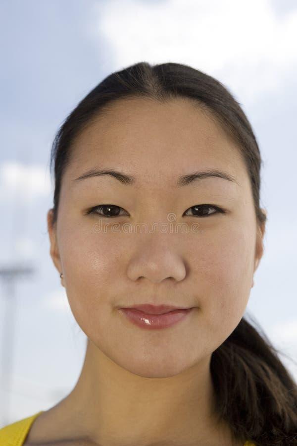Atleta fêmea asiático feliz foto de stock royalty free