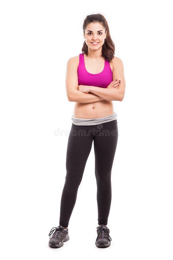 Atleta fêmea bonito em um estúdio fotografia de stock royalty free