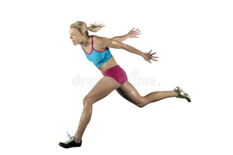 Atleta femminile che esegue una corsa immagine stock libera da diritti