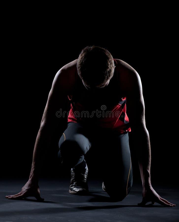 atleta przygotowywający początek obrazy stock