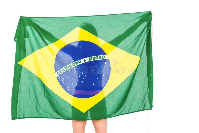 Atleta que levanta com a bandeira brasileira após a vitória fotos de stock royalty free