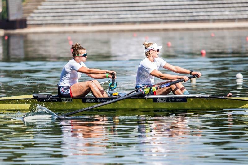 Atletas de Gran Bretaña en un rowing de la competencia de la taza del mundo que rema imagen de archivo libre de regalías