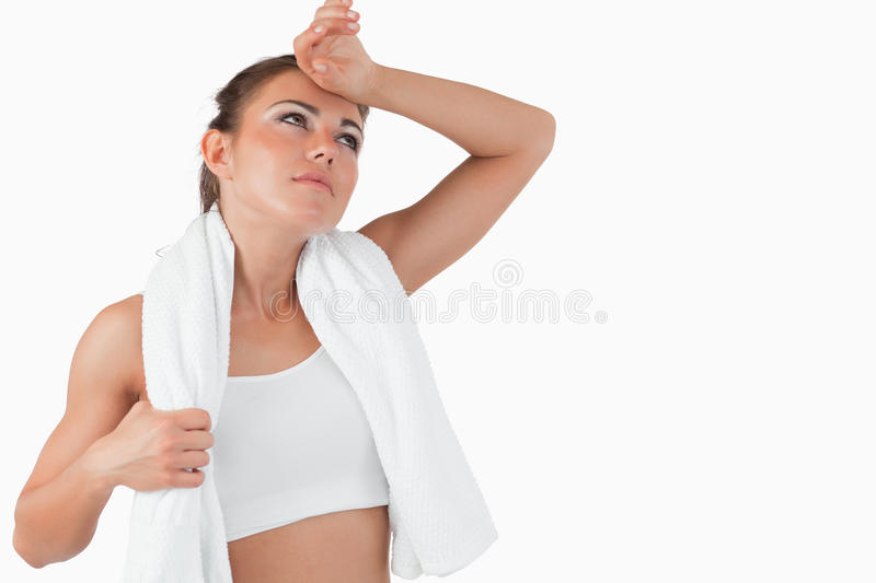 Download Atletic Female Wiping Sweat Off Her Forehead Stock Image - Image: 21973465