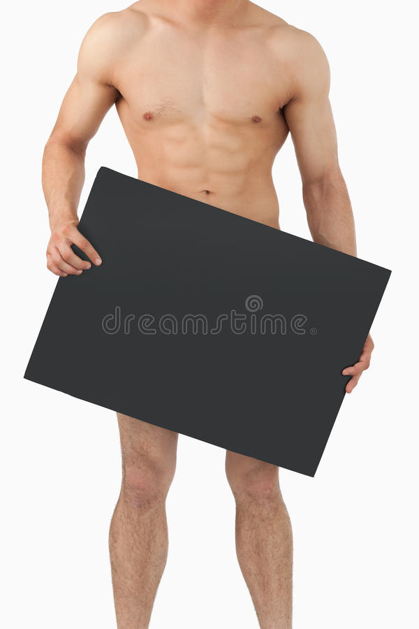 Atletic male body holding banner in his hands royalty free stock photo