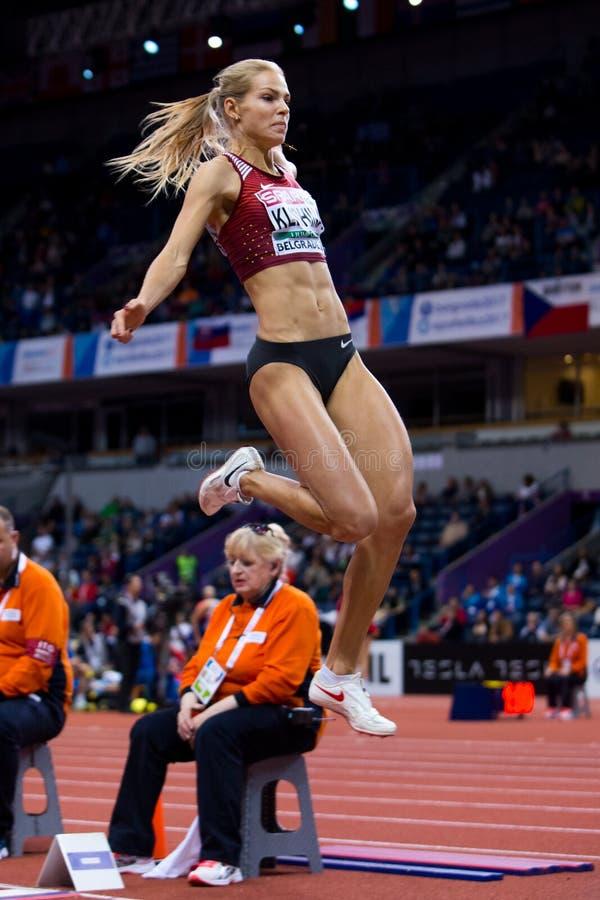 Atletica - salto in lungo della donna, KLISHINA Darya immagine stock