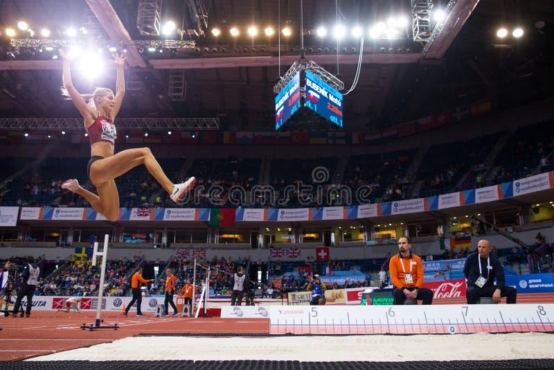 Atletica - salto in lungo della donna, KLISHINA Darya fotografie stock