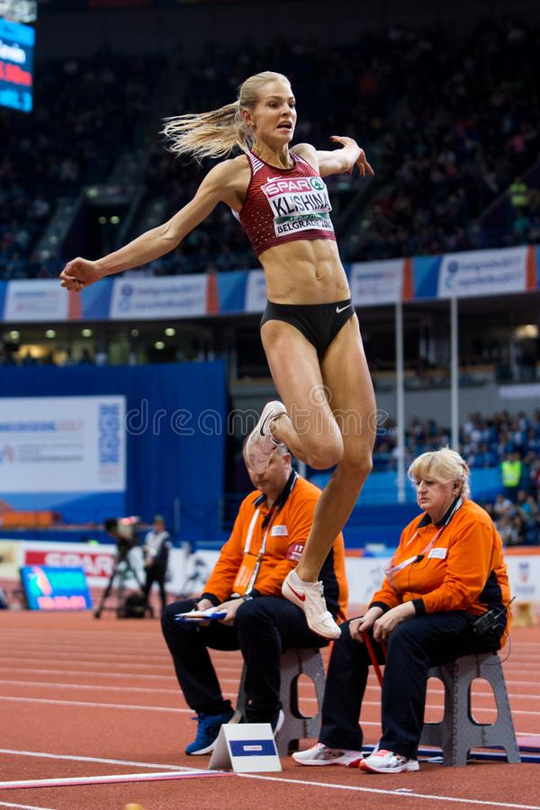 Atletica - salto in lungo della donna, KLISHINA Darya fotografia stock libera da diritti