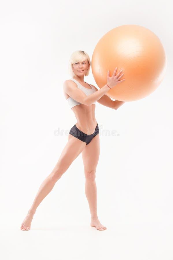 Atletisch lichaam van een perfecte vrouw stock foto