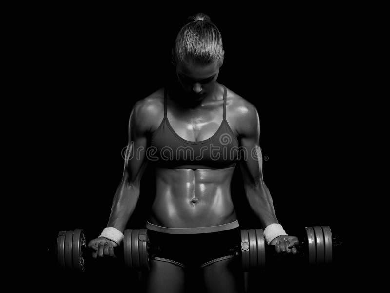 Atletische bodybuildervrouw met domoren meisje met spieren royalty-vrije stock foto's