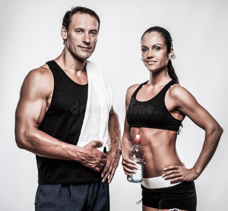Atletische man en vrouw stock afbeeldingen