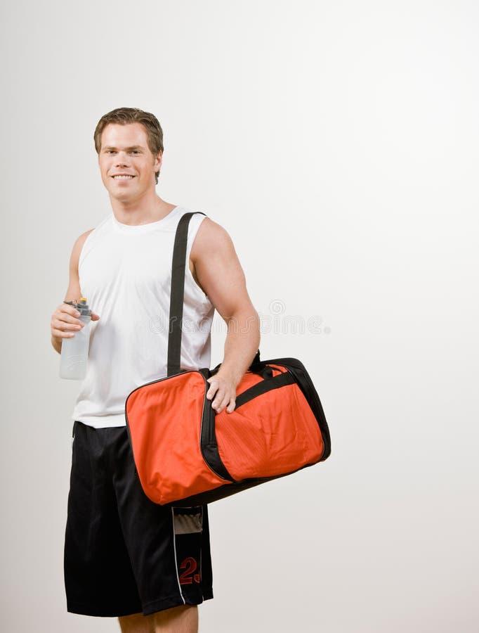 atlety torby butelki gym mienia woda zdjęcia stock