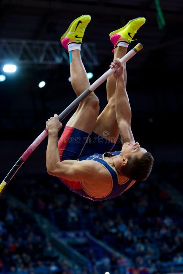 Atletyka - Mihail Dudas; Mężczyzna Heptathlon, słup krypta zdjęcia stock