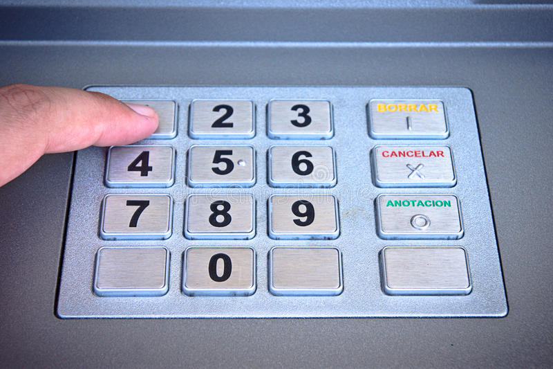 Atm. Man finger pushes atm numbers royalty free stock photography
