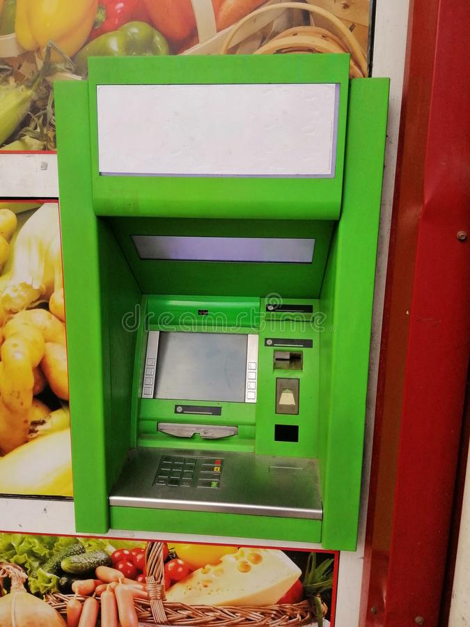 ATM for cash withdrawals by bank cards, green stock images