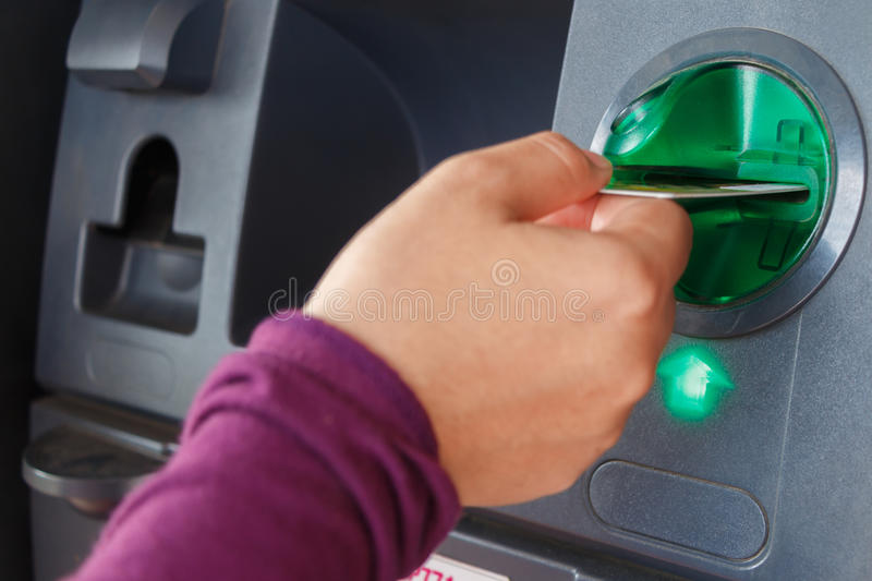 ATM close-up. With woman hand stock image