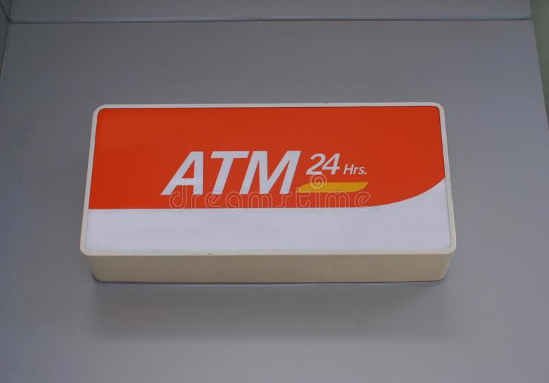 ATM 24 Hrs sign. Sign directing to an Automated teller machine, automatic teller machine, ATM, Automated banking machine, ABM, cash machine, cashpoint, cashline royalty free stock image