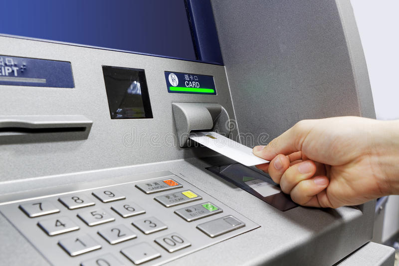 ATM insert card. Male hand businessman inserts credit card into the ATM and withdraws money royalty free stock photo