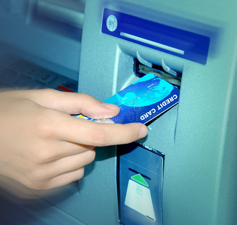 ATM. Inserting A Card. stock photo