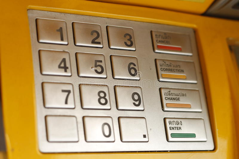 ATM keypad machine detail. Cash point close up. Yelllow stock images