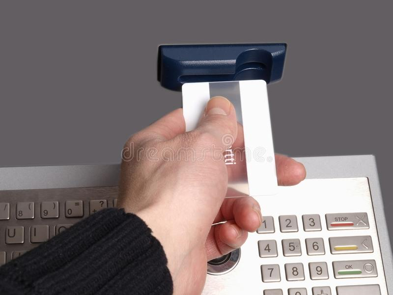 ATM machine. Someone inserting a card into a ATM machine, on white background royalty free stock photo