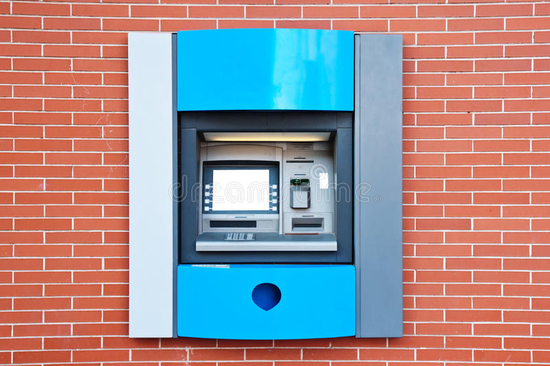 Atm machine. In a brick wall royalty free stock image