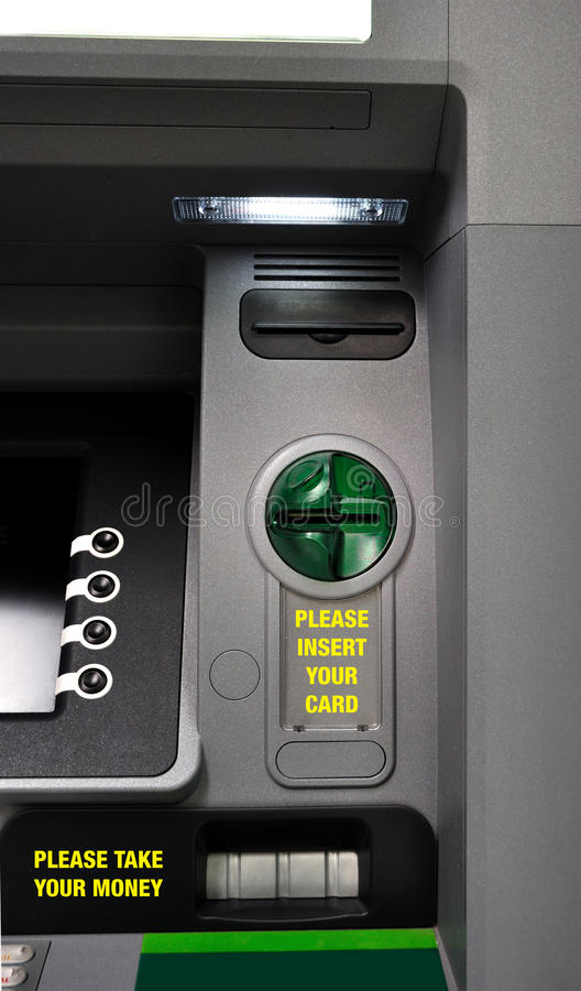 ATM machine detail. This photograph represent an ATM with clear instructions about its operations stock image