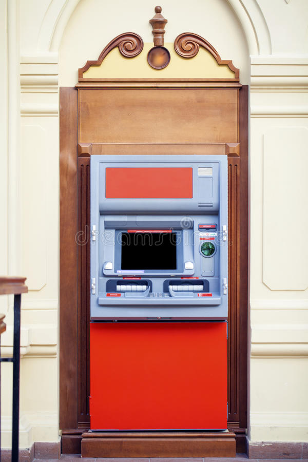 ATM in the mall without people. Red ATM in the mall without people, indoor shop stock photography