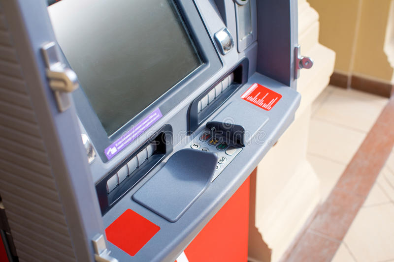 ATM in the mall without people. Red ATM in the mall without people, indoor shop royalty free stock photography