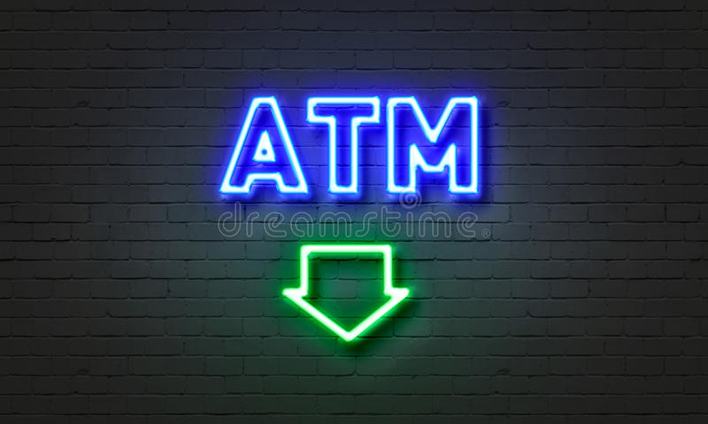 ATM neon sign on brick wall background. royalty free stock image