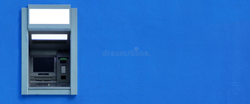 ATM oder ABM oder Cashpoint-Maschine Byilt-in der blauen Wand stockfotografie