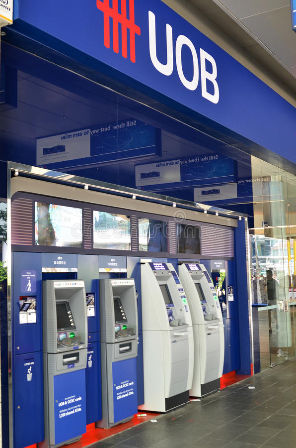 ATM of United Overseas Bank in Singapore. SINGAPORE- MAY 01, 2017: ATM of United Overseas Bank UOB in Singapore, one of the largest banks in South-East Asia stock photos