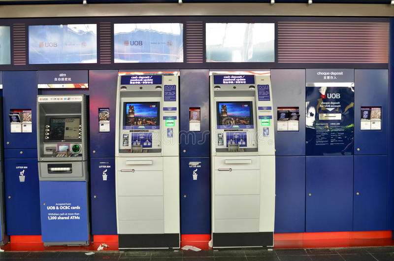 ATM of United Overseas Bank in Singapore. SINGAPORE- MAY 01, 2017: ATM of United Overseas Bank UOB in Singapore, one of the largest banks in South-East Asia stock photography