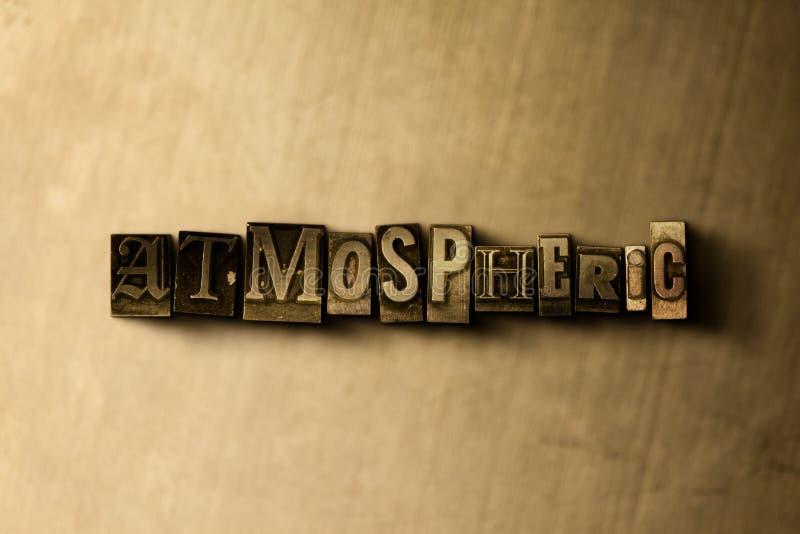 ATMOSFÄRISKT - närbild av det typsatta ordet för grungy tappning på metallbakgrunden royaltyfri illustrationer