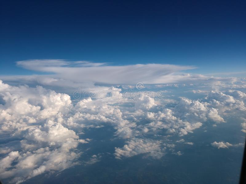 Atmosphere clouds scattered and diverse. Space above and Earth below clouds divided above and below the Stratosphere royalty free stock images
