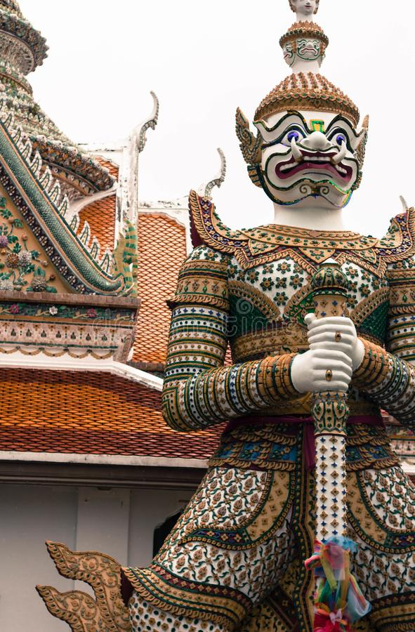 Stone statues of mythical warriors in the temple of wat arun bangkok thailand stock images