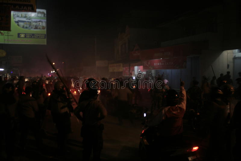 Atmosphere mass destruction Setia Hati Teratai on Pasar Nusukan, Solo city. Police perform vital security and mass dispel night royalty free stock images