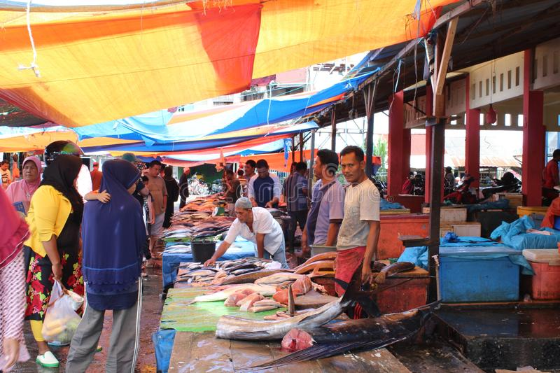 Tradisional fish market in meulaboh aceh barat. Atmosphere traditional fish market in meulabuh aceh barat on daytime looks crowded stock image