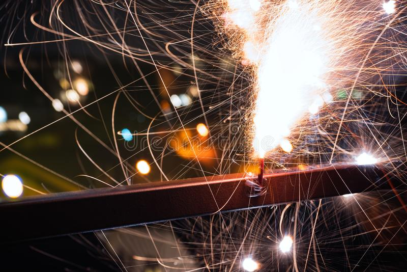 Atmospheric close-up of an exploding firecracker with a beautiful bokeh. New Year`s Eve. stock photos