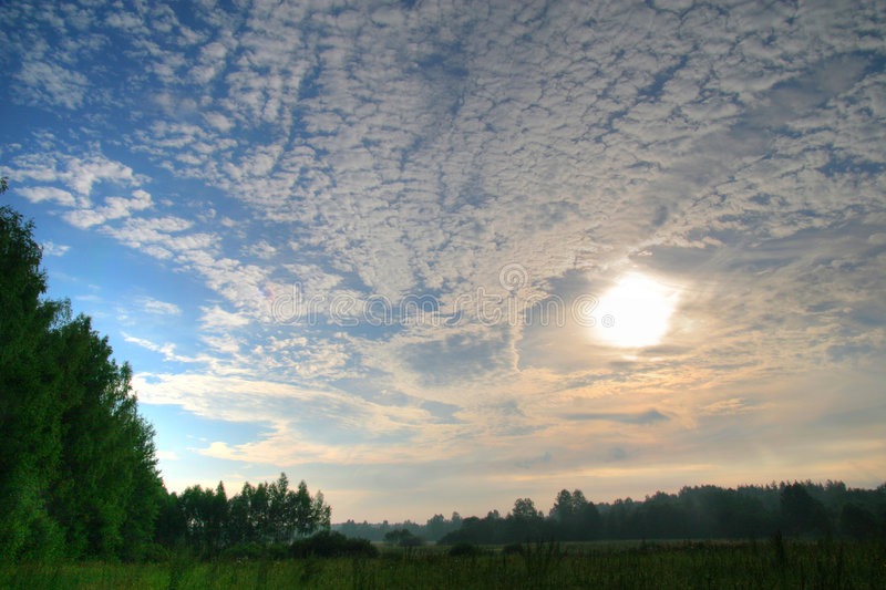Atmospheric clouds over sun