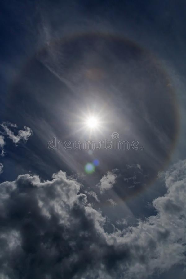 Atmospheric Phenomena Halo. Halos are atmospheric phenomena created by light which is reflected or refracted by ice crystals in the atmosphere. Halos can have royalty free stock photo
