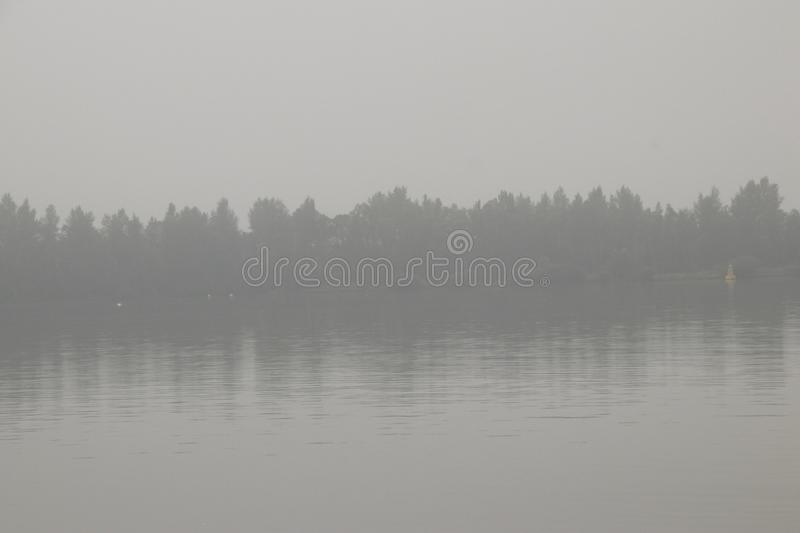 Atmospheric scene in a light misty landscape. Netherlands, Flevoland, North, Oost, Polder,Schokker harbor,Veluwemeer,july2018: atmospheric scene in a light misty stock photo