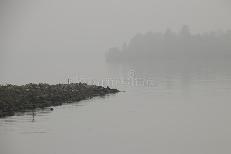 Atmospheric scene in a light misty landscape. Netherlands, Flevoland, North, Oost, Polder,Schokker harbor,Veluwemeer,july2018: atmospheric scene in a light misty royalty free stock images