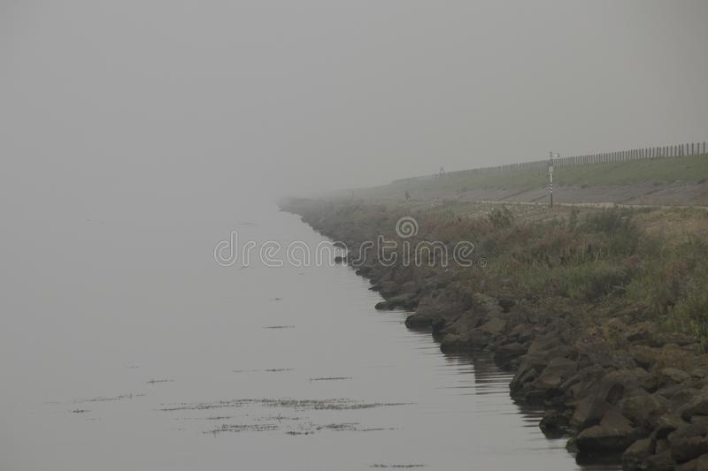Atmospheric scene in a light misty landscape. Netherlands, Flevoland, North, Oost, Polder,Schokker harbor,Veluwemeer,july2018: atmospheric scene in a light misty royalty free stock photos