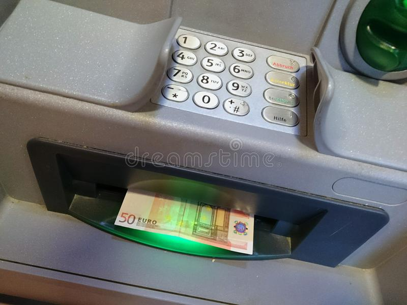 ATMs. An German ATM and a fifty euro note stock image